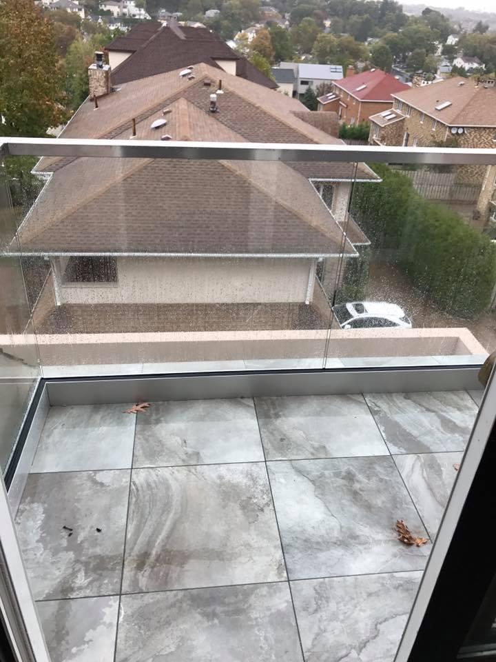 Outdoor Balcony With Glass Railings Installation